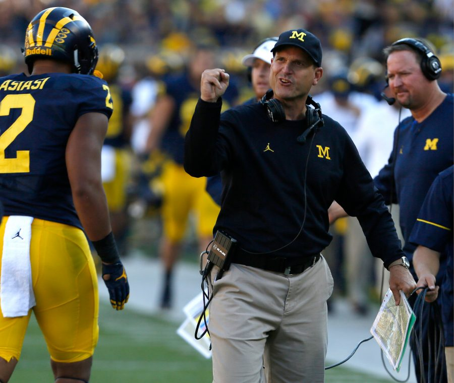 Michigan head coach Jim Harbaugh encourages his players coming off the field late in the first half against Penn State at Michigan Stadium in Ann Arbor, Mich., on Saturday, Sept. 24, 2016. Michigan won, 49-10. (Eric Seals/Detroit Free Press/TNS)