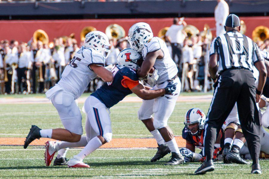 Illinois+linebacker+Hardy+Nickerson+tackles+Western+Michigan+running+back+Jarvion+Franklin+during+the+the+game+against+Western+Michigan+at+Memorial+Stadium+on+Sept.+17.+