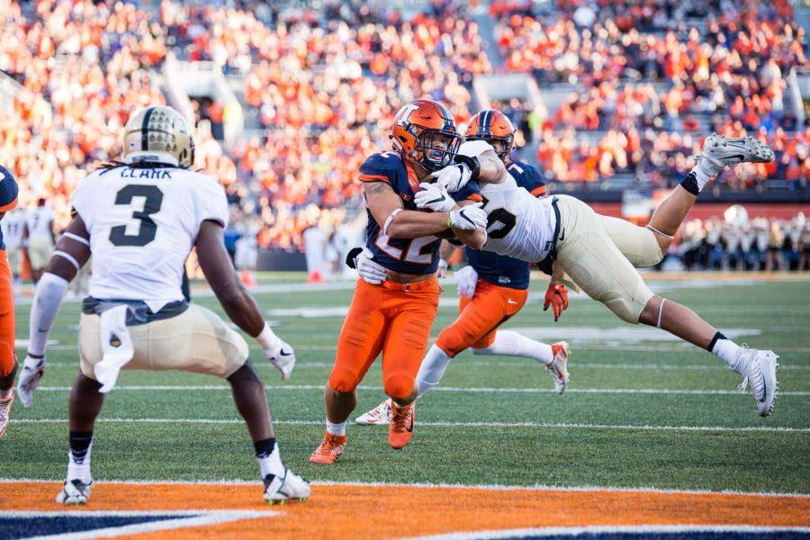 Illinois running back Kendrick Foster (22) runs through a tackle for a touchdown during the game against Purdue at Memorial Stadium on October 8. The Illini lost 34-31.