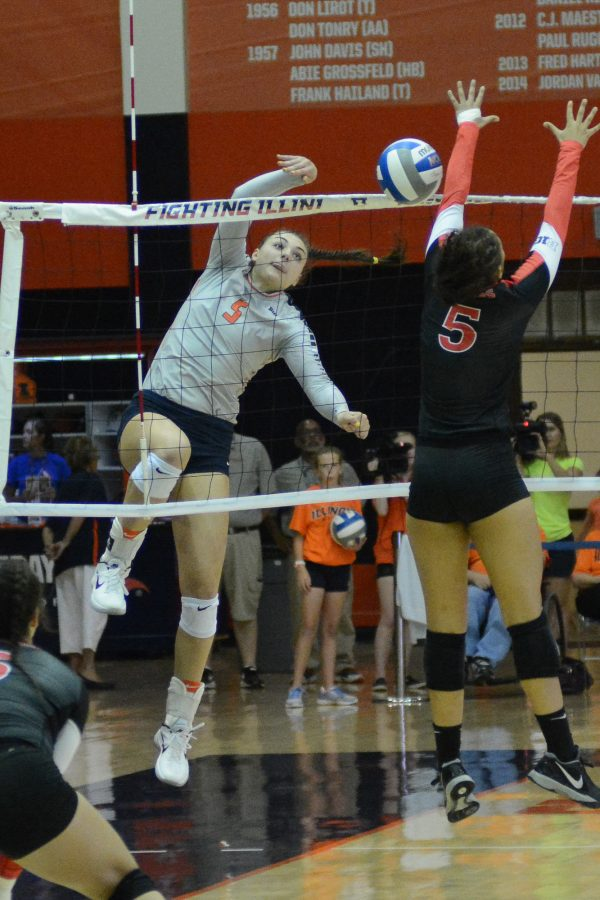 Ali Bastianelli (5) spikes the ball down during the game. Illini won 3-0 against Rutgers.