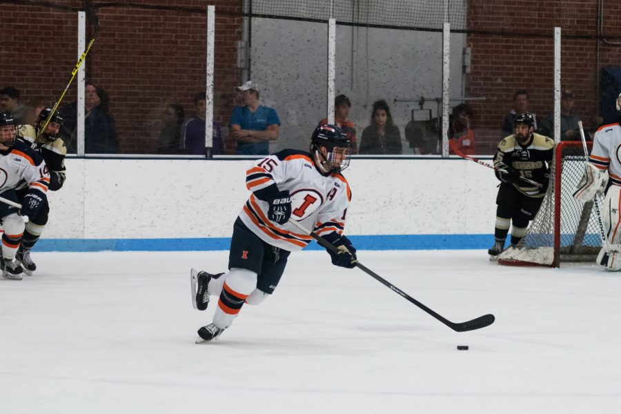 Illinois%27+Eric+Cruickshank+carries+the+puck+up+the+ice+during+the+game+against+Lindenwold+University+at+the+Ice+Arena+on+Saturday%2C+January+30.+The+Illini+lost+4-1.