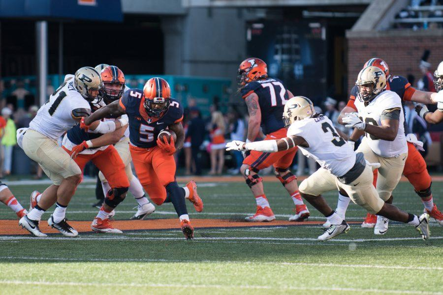 Illinois running back Ke'Shawn Vaughn weaves through the defense in the game against Purdue at Memorial Stadium on October 8. The Illini lost 34-31.