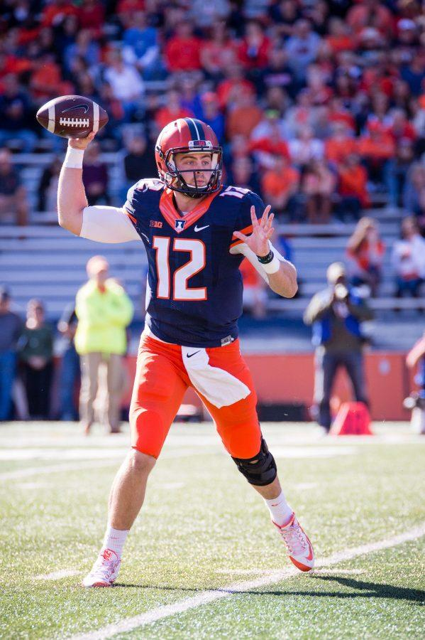 Illinois quarterback Wes Lunt (12) passes the ball during the game against Purdue at Memorial Stadium on Saturday, October 8. The Illini lost 34-31.