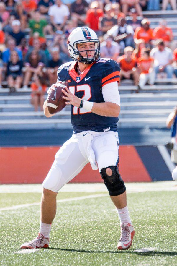 Illinois+quarterback+Wes+Lunt+%2812%29+looks+to+pass+the+ball+during+the+first+half+of+the+game+against+Western+Michigan+at+Memorial+Stadium+on+Saturday%2C+September+17.+The+Illini+are+losing+24-7+at+half.