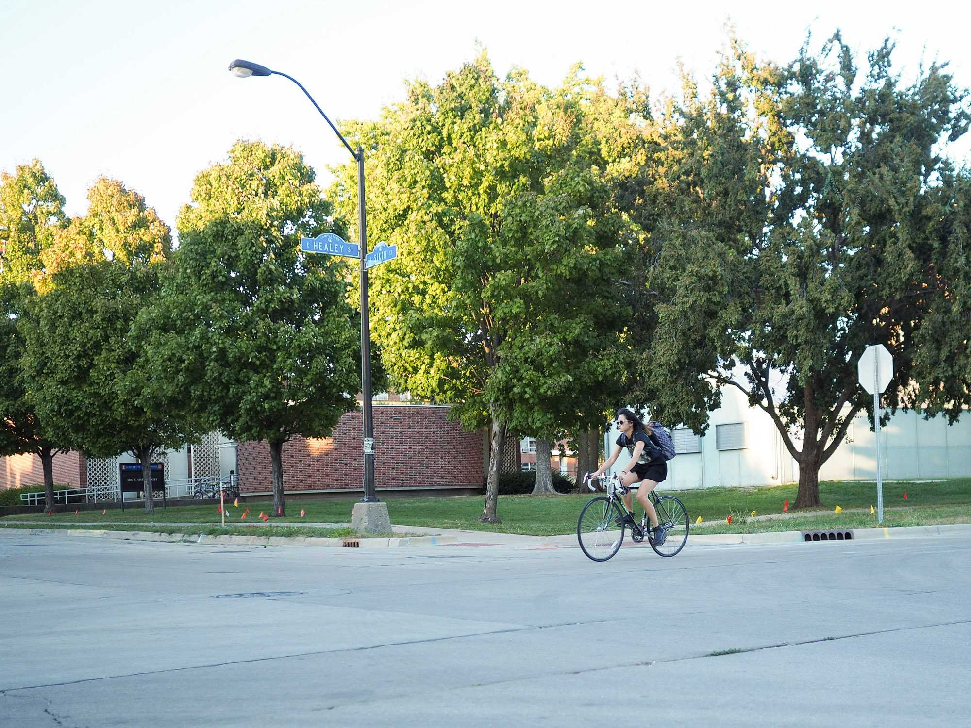 Student bikes through Sixth and Healey intersection in Champaign, IL. October 11, 2016.