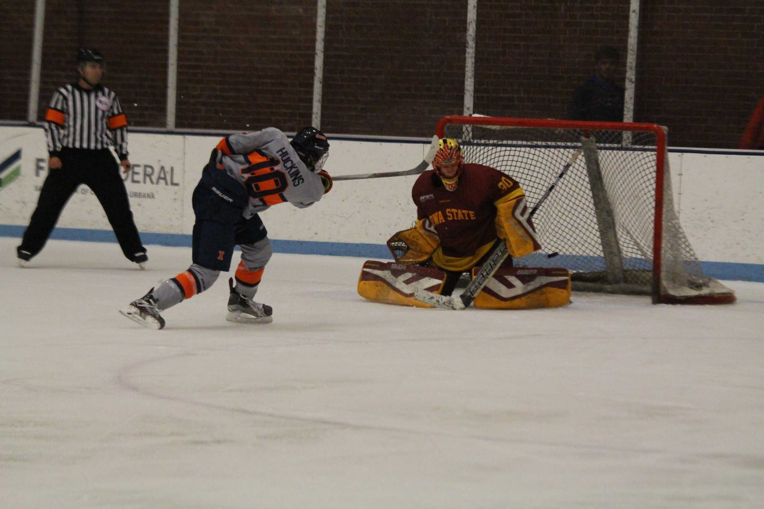 Kendall Huckins (10) takes his penalty shot against Iowa State's goalie and gets a point for Illinois to keep it a close game at the Ice Arena on Friday, Oct. 28, 2016. Illini lost 5-4 to Iowa State in a shootout.