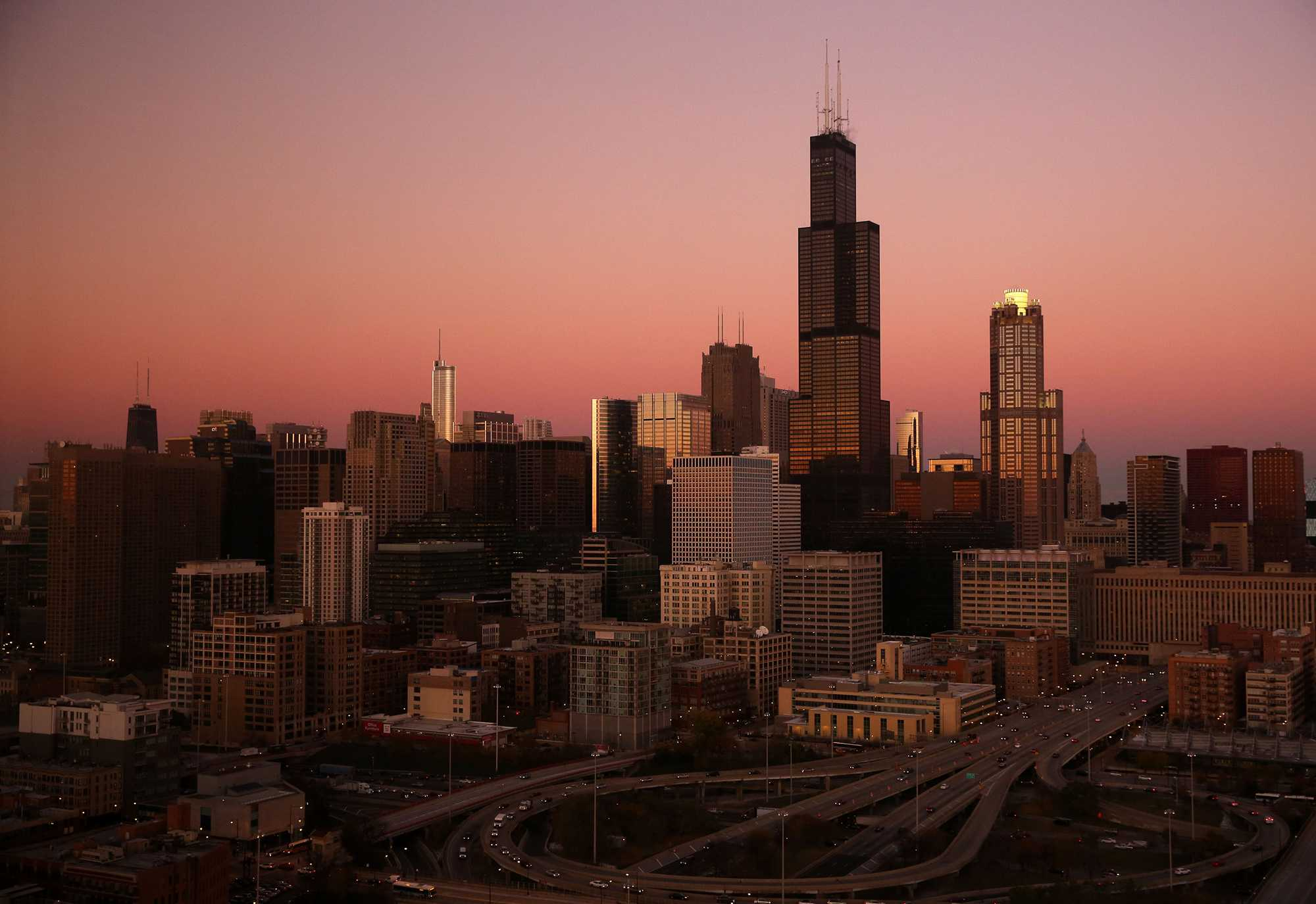 The sun sets upon the Chicago skyline in November 2013. Illini Fest attracted Chicago-based University alumni on July 18 with nostalgia-inducing exhibits.