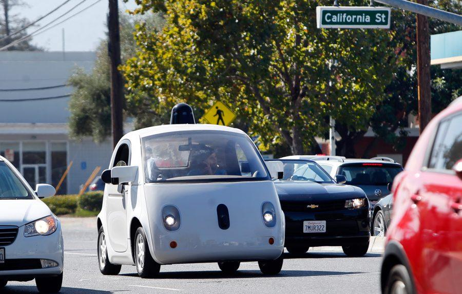 A Google Self Driving Car Travels Eastbound On
