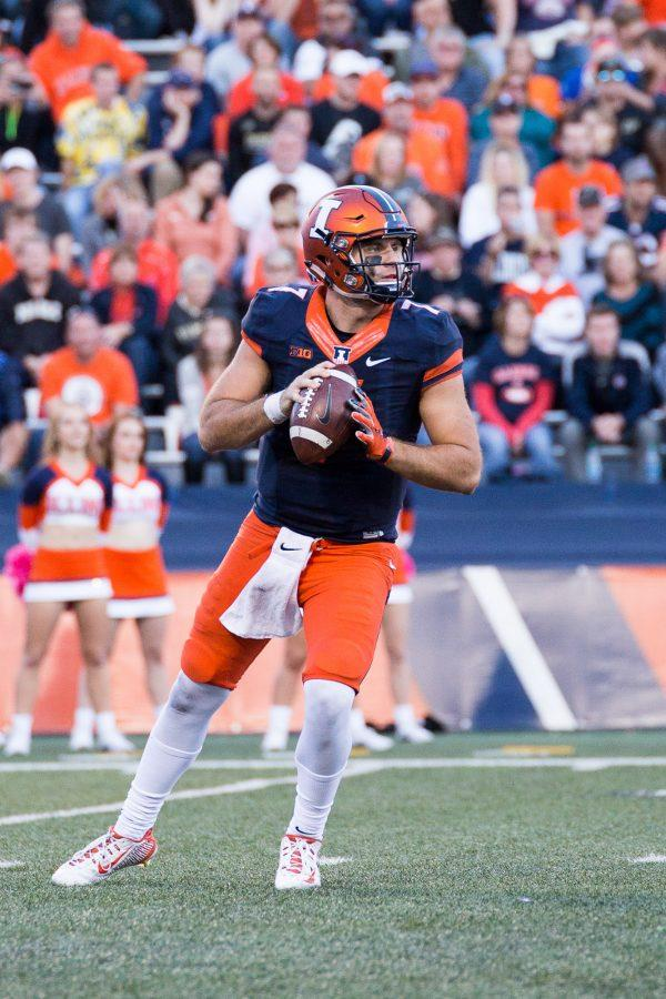 Illinois backup quarterback Chayce Crouch (7) looks to pass the ball during the game against Purdue at Memorial Stadium on Saturday, October 8. The Illini lost 34-31.