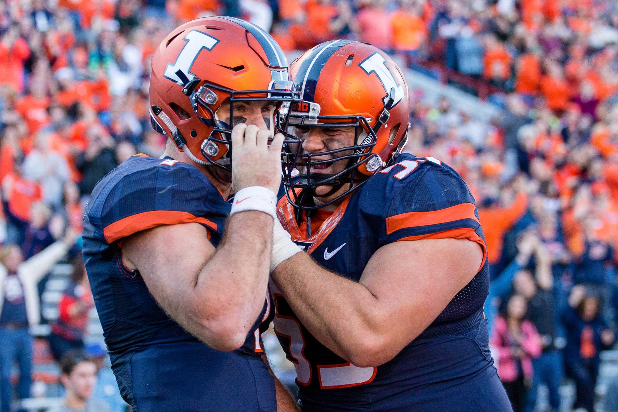 Illinois offensive lineman Nick Allegretti (53) grabs backup quarterback Chayce Crouch (7) after he scored a touchdown in the game against Purdue at Memorial Stadium on Oct. 8. The Illini lost 34-31.