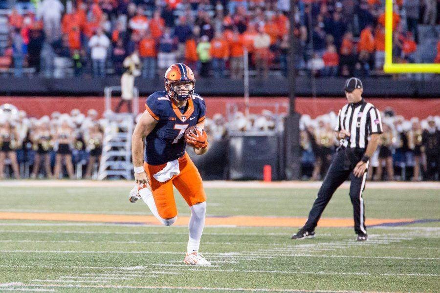 Illinois backup quarterback Chayce Crouch runs down the field during the game against Purdue at Memorial Stadium on Saturday, October 8.