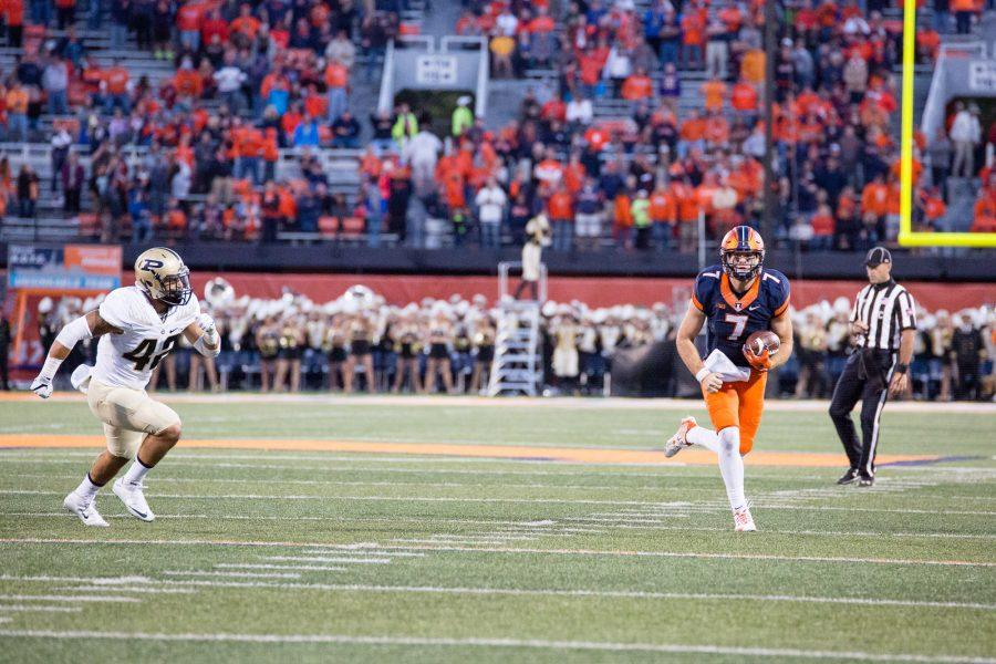 Illinois backup quarterback Chayce Crouch (7) runs down the field during the game against Purdue at Memorial Stadium on Saturday, October 8. The Illini lost 34-31.