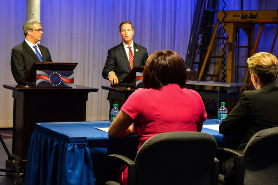 Democrat Mark Wicklund and Republican Rodney Davis respond to questions from moderators at the Illinois 13th Congressional District Debate Thursday night at the WILL-TV studio on the University of Illinois campus.