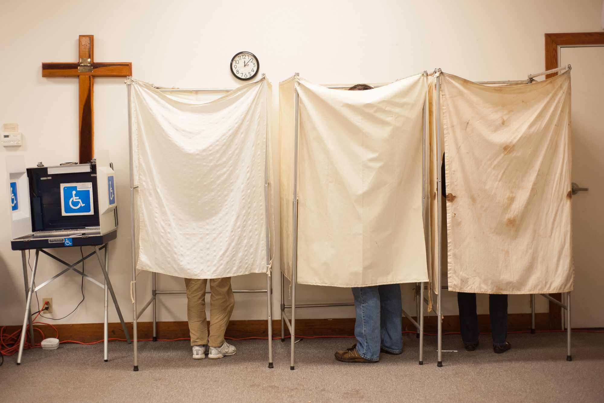 Voters stand in booths at the Salvation Army in Champaign, on election day, Tuesday, Nov. 6, 2012.
