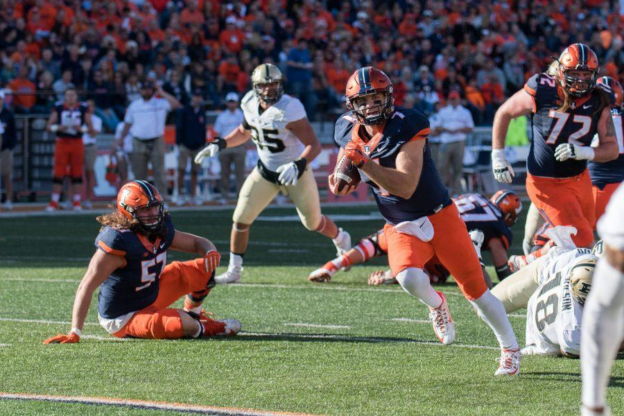 Illinois+quarterback+Chayce+Crouch+runs+for+a+touchdown+in+the+game+against+Purdue+at+Memorial+Stadium+on+October+8.+The+Illini+lost+34-31.