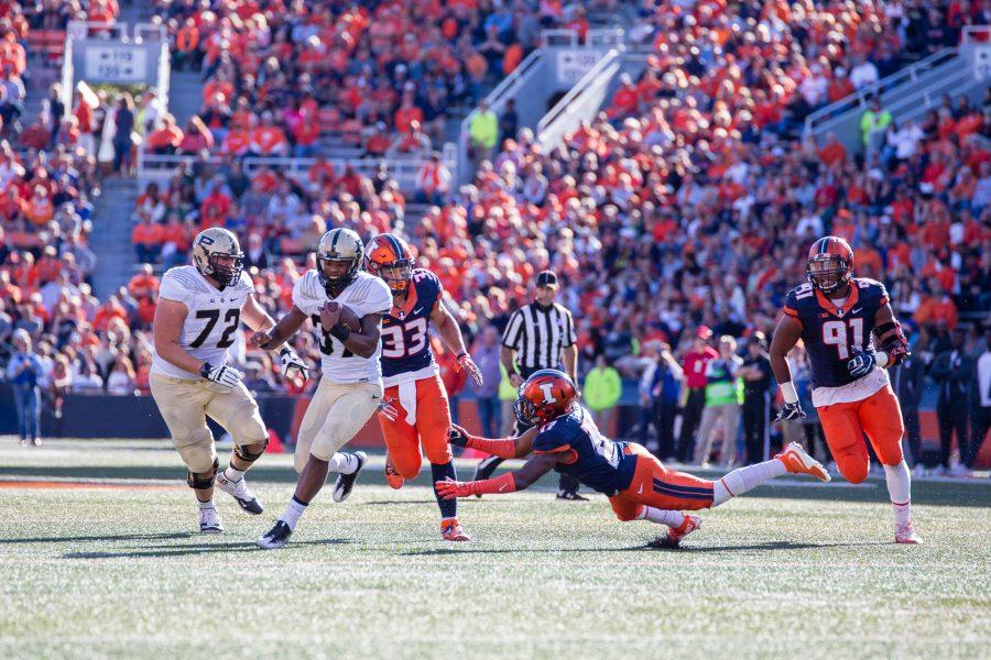 Illinois defensive back Stanley Green (17) dives after Purdue running back Brian Lankford-Johnson (37) during the game at Memorial Stadium on Saturday, October 8. The Illini lost 34-31.
