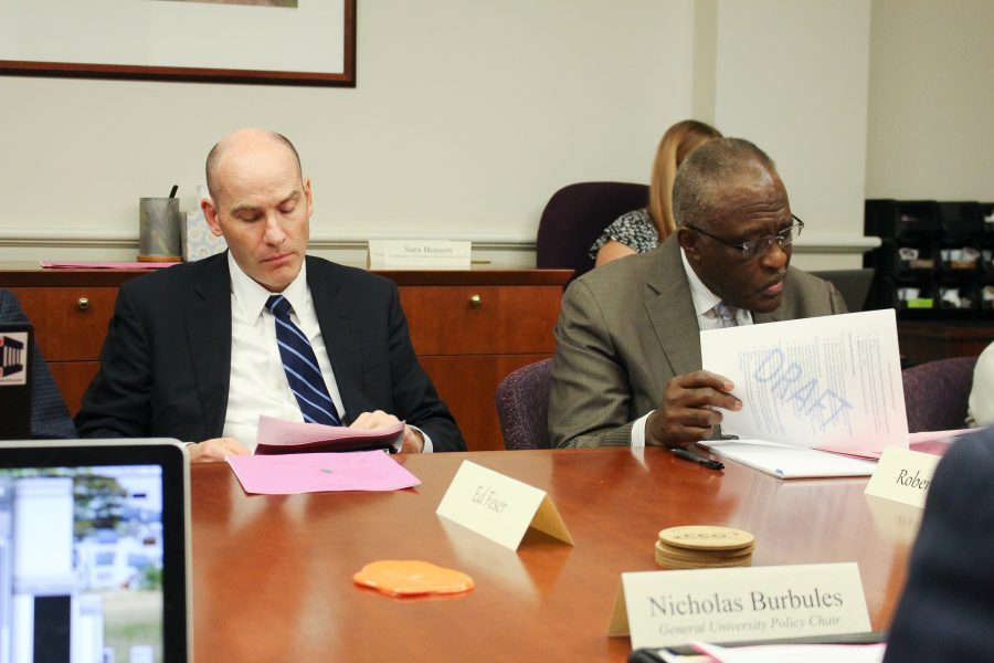 Chancellor Robert Jones and Interim Vice Chancellor for Student Affairs and Provost Ed Feser go over documents at the Senate Executive Committee meeting on Monday.