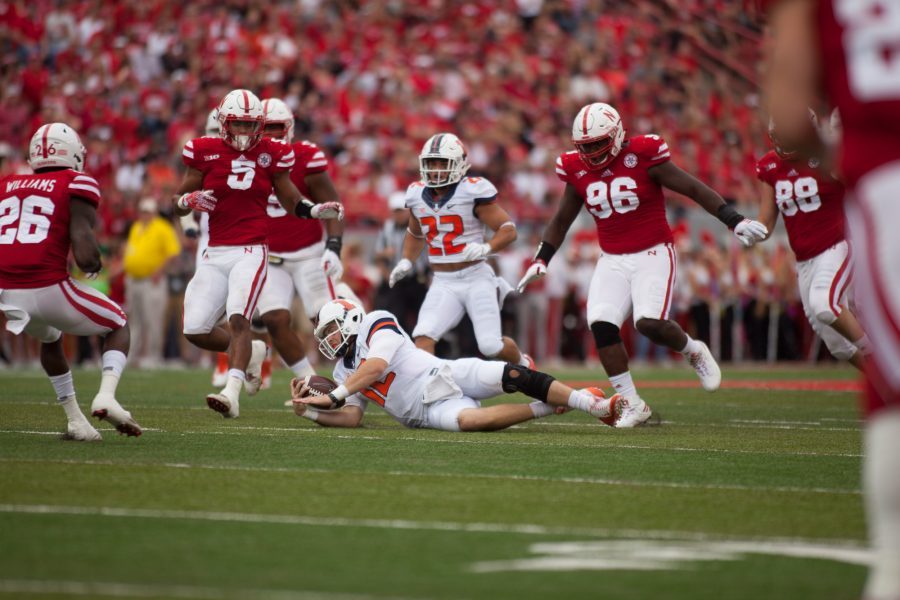 Illinois quarterback Wes Lunt (12) falls during the game against Nebraska at Memorial Stadium (Lincoln).