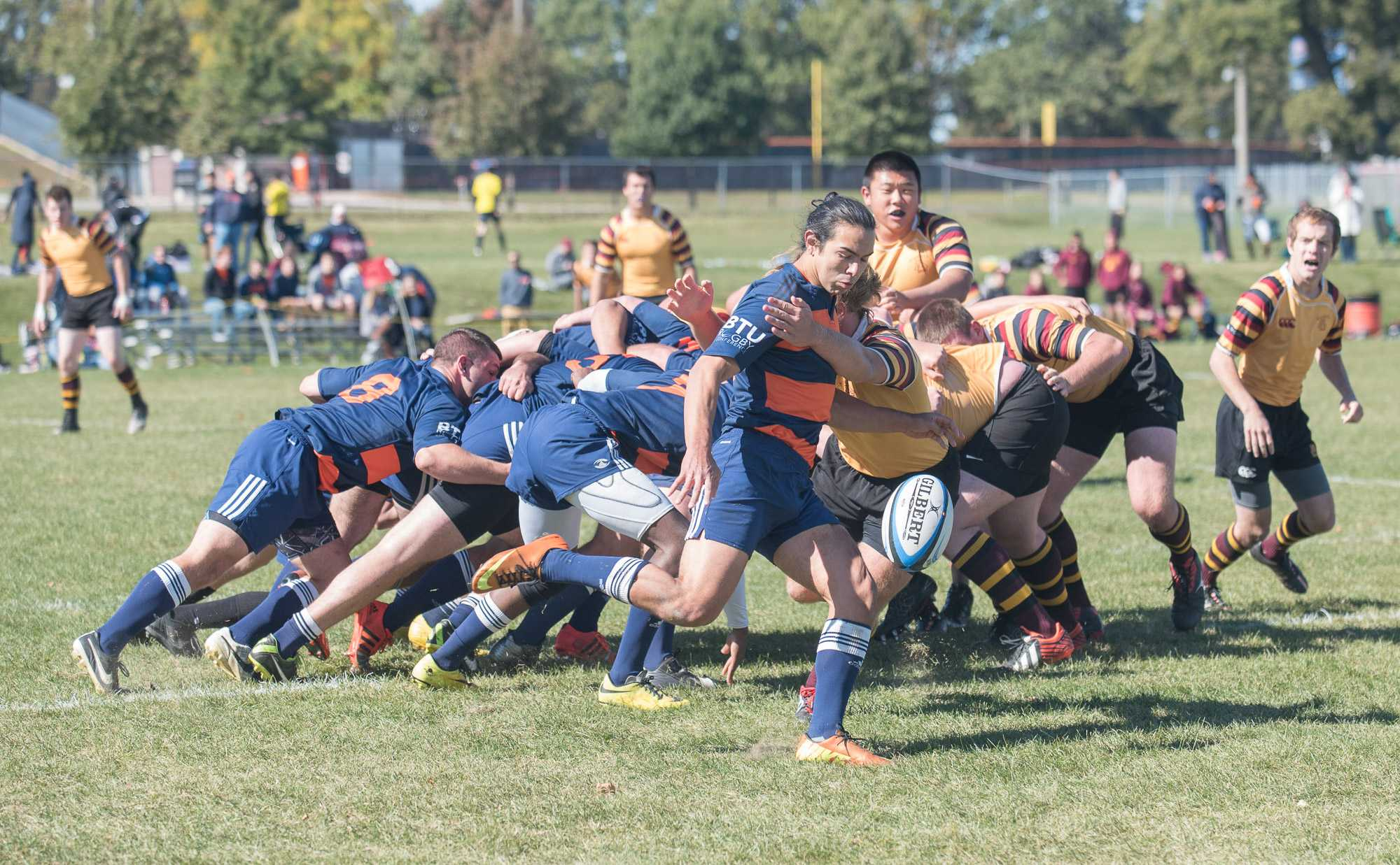 After retrieving the ball from the scrum, Mario Lozano drop kicks the ball down the field during the game against Minnesota at the Complex Fields on Saturday, October 17.
