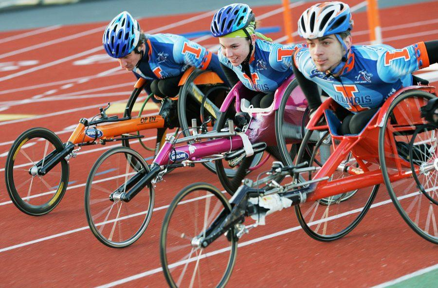 Amanda McGrory, center, who placed second in the women's wheelchair division of the Boston Marathon on Monday, practices at the Illinois Track Stadium on Monday, April 9, 2007, with teammates Cully Mason, right, and Josh George, left, who placed 10th in the marathon.