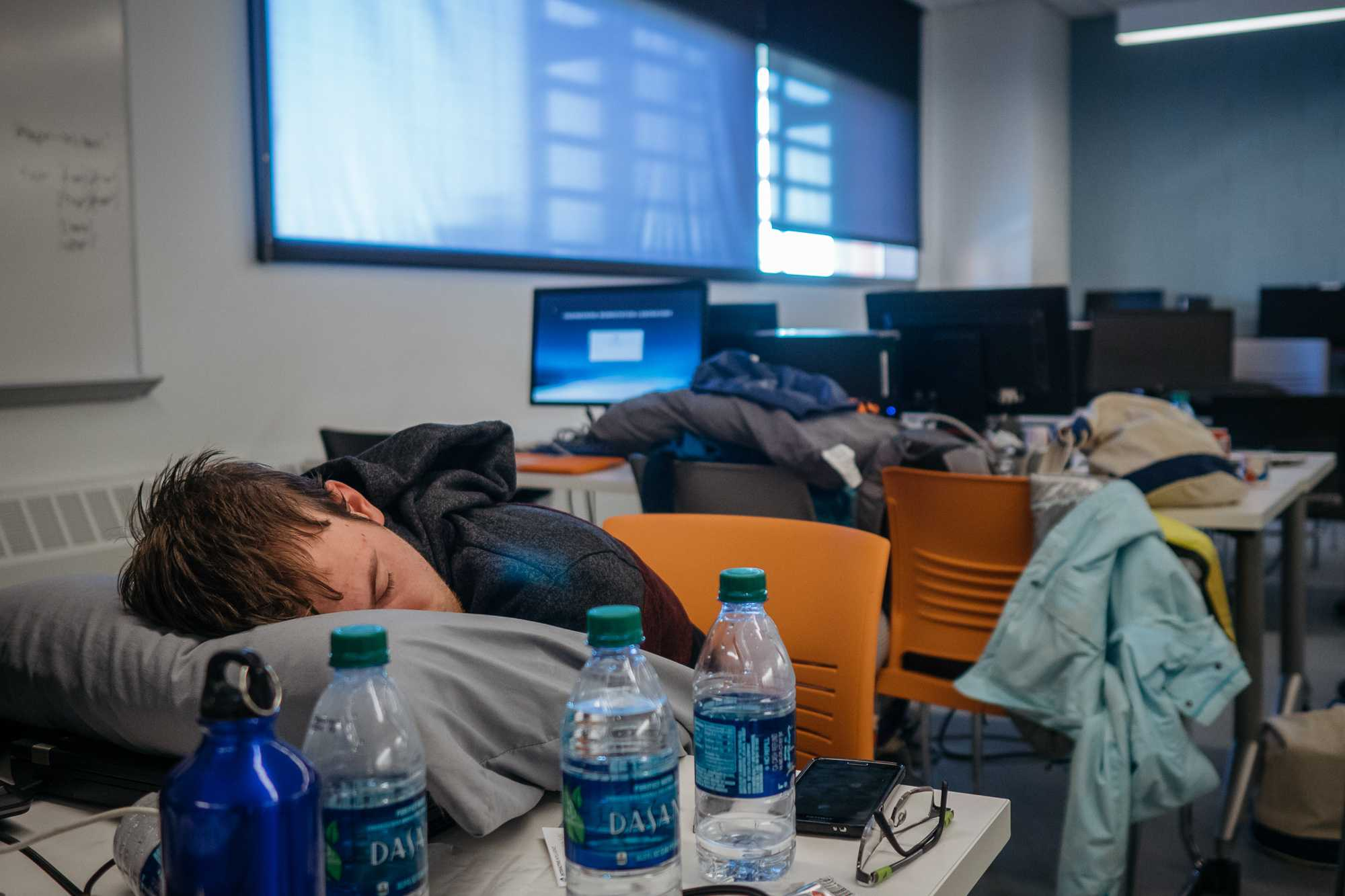 A student sleeps in the undergraduate students lounge of the Electrical and Computer Engineering building after two days of hacking on Sunday, Feb 21 2016.