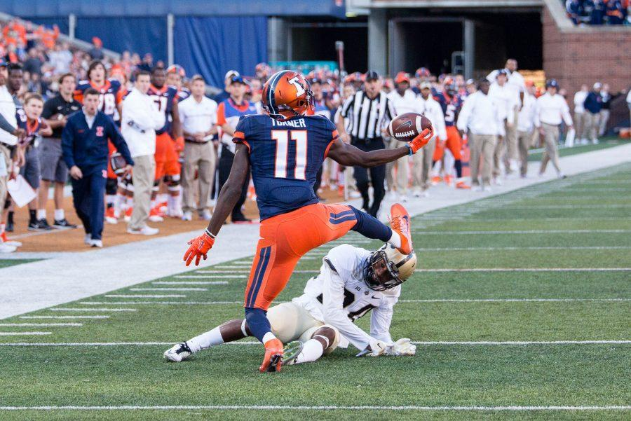 Illinois wide receiver Malik Turner (11) makes a one handed catch after bobbling the ball during the game against Purdue at Memorial Stadium on October 8. The Illini lost 34-31.