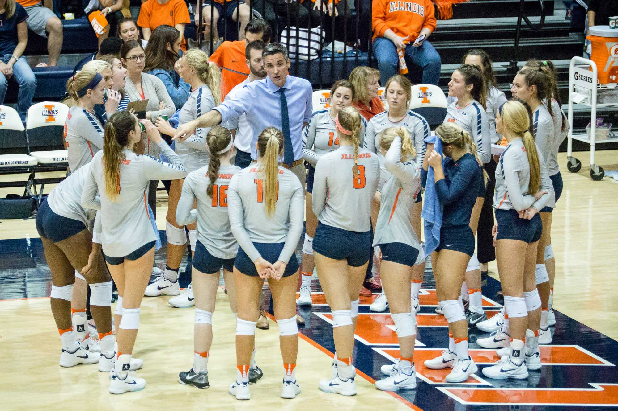 Illinois head coach Kevin Hambly talks to his team during a timeout in the match against Northwestern at Huff Hall on Saturday, October 15. The Illini won 3-0.