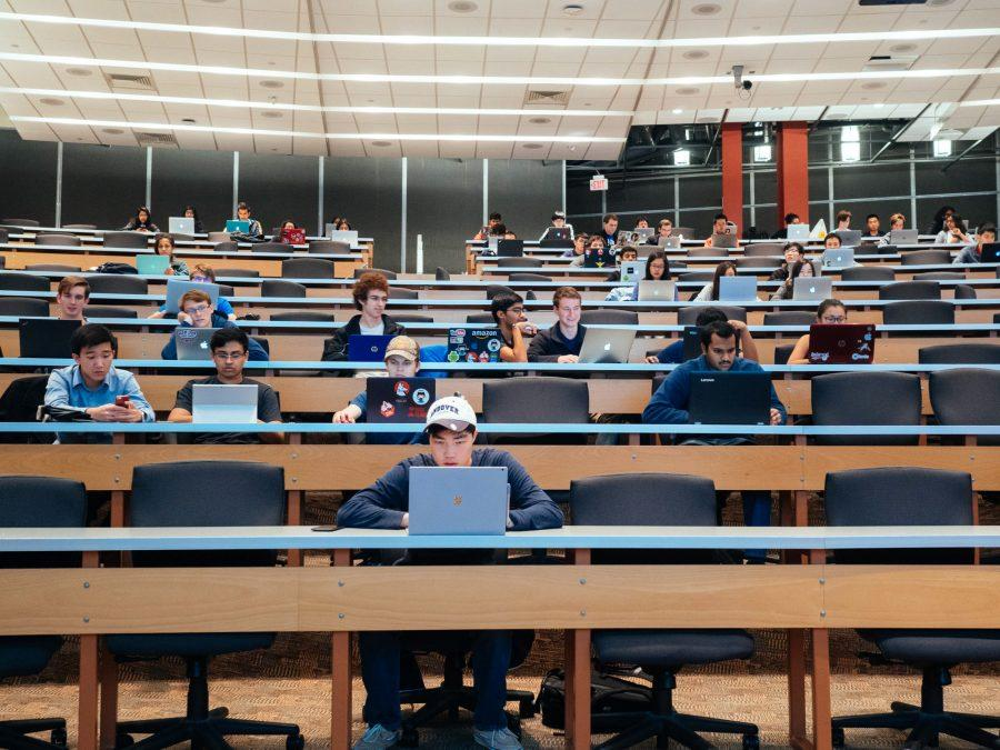 Students get ready for the honors section of CS 196: Intro to Computer Science for CS Majors on Tuesday night in the Seibel lecture hall.