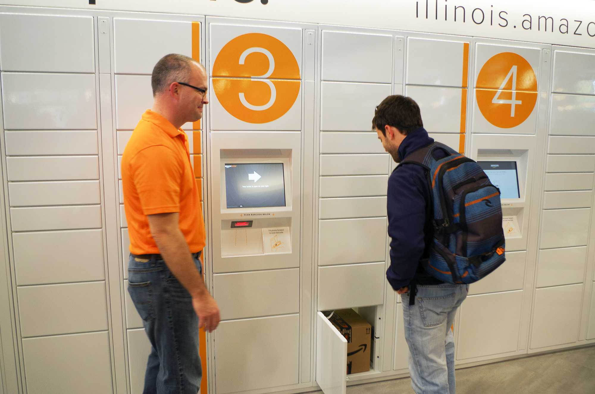 Amazon Employees show customers how to use the easy, and fast, Amazon Pick up services located in the Illini Union Bookstore. All you need is your mobile device and code from Amazon to access the locker with your package inside. The pick up location's Grand Opening was on Wednesday, November 16th.