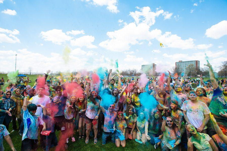 U of I students celebrate the annual Holi festival at the Florida and Lincoln Playing Field on Saturday afternoon, April 16, 2016.