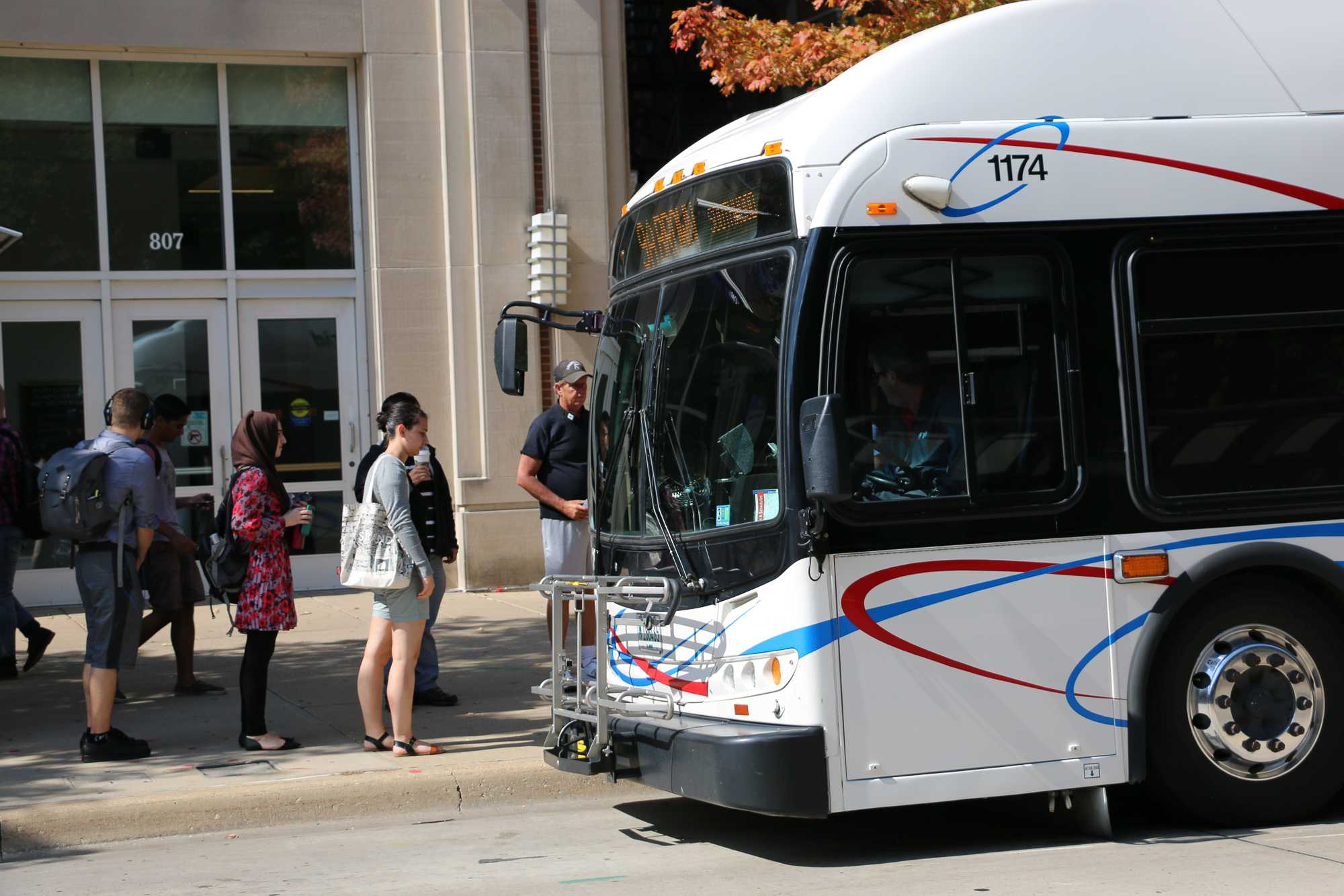 Students board a CUMTD bus at Transit Plaza. MTD's SafeRides plans to launch its own app in August.