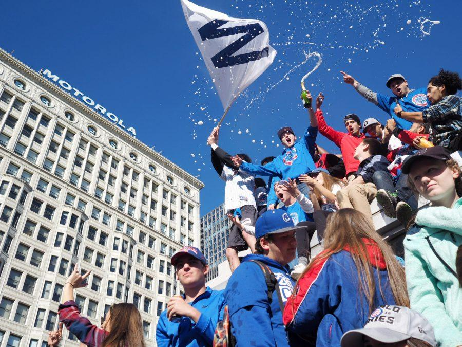 Citizens and Chicago Cubs fans celebrate at the 2016 World Series Rally in Chicago on Friday.