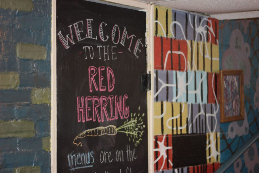 A sign welcomes visitors to the Red Herring.