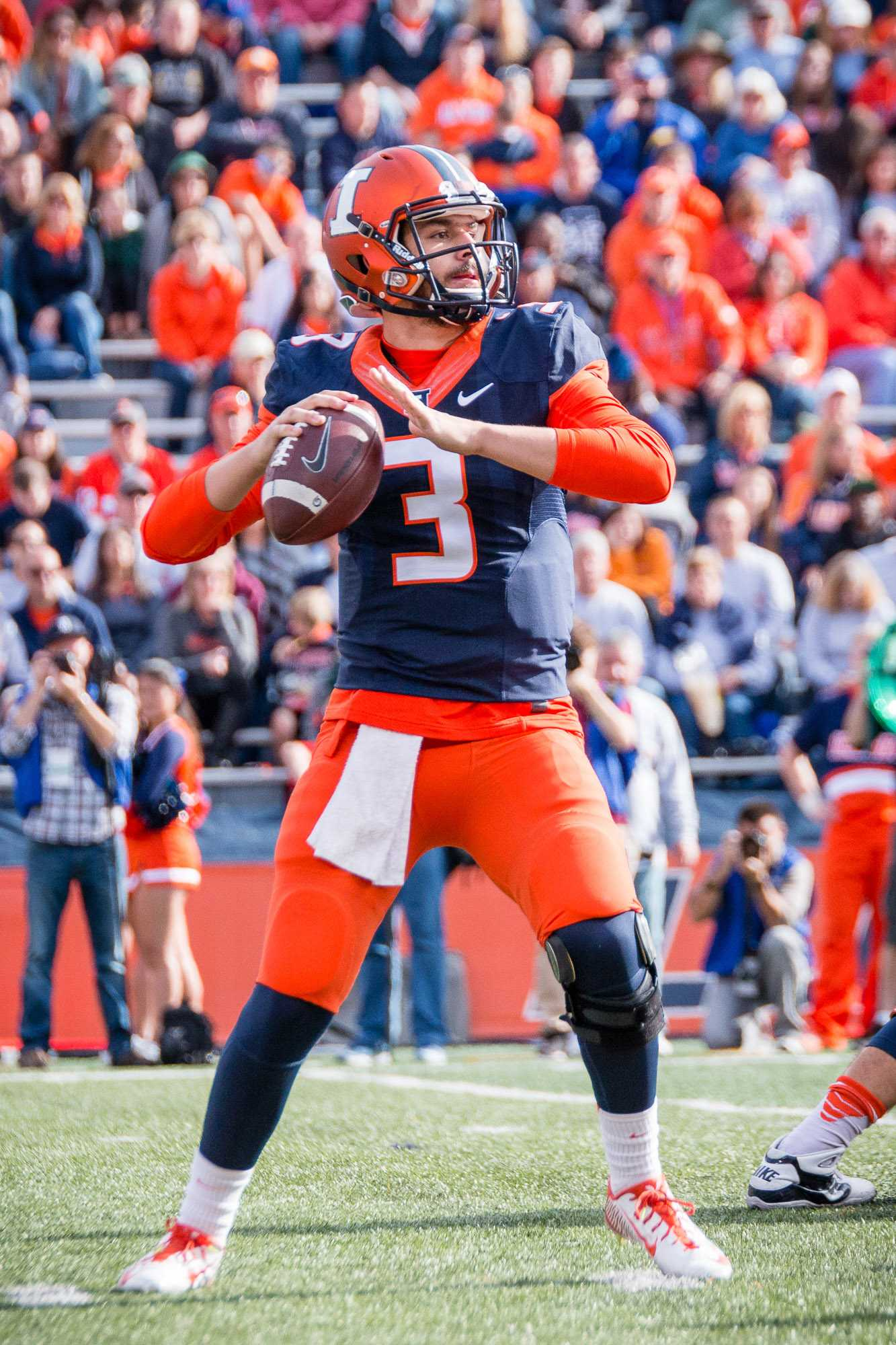 Illinois quarterback Jeff George Jr. looks to pass the ball during the game against Michigan State at Memorial Stadium on Saturday, November 6.