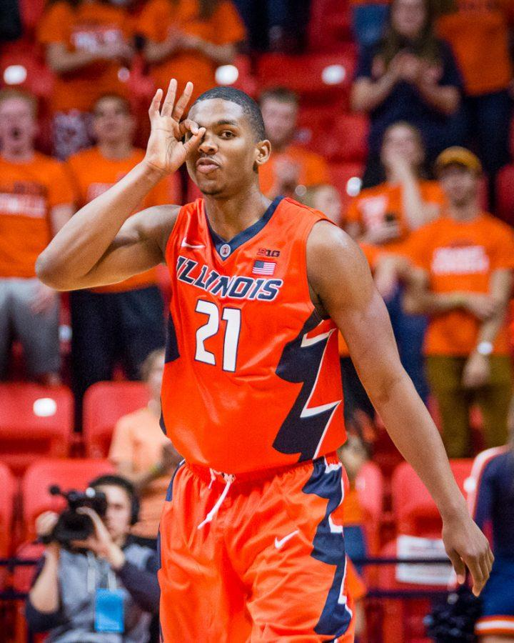 Illinois' Malcolm Hill (21) throws up the three goggles after hitting a three-pointer in the game against Northern Kentucky at State Farm Center on Sunday, November 13. Hill scored 40 points in the Illini's 79-64 win.