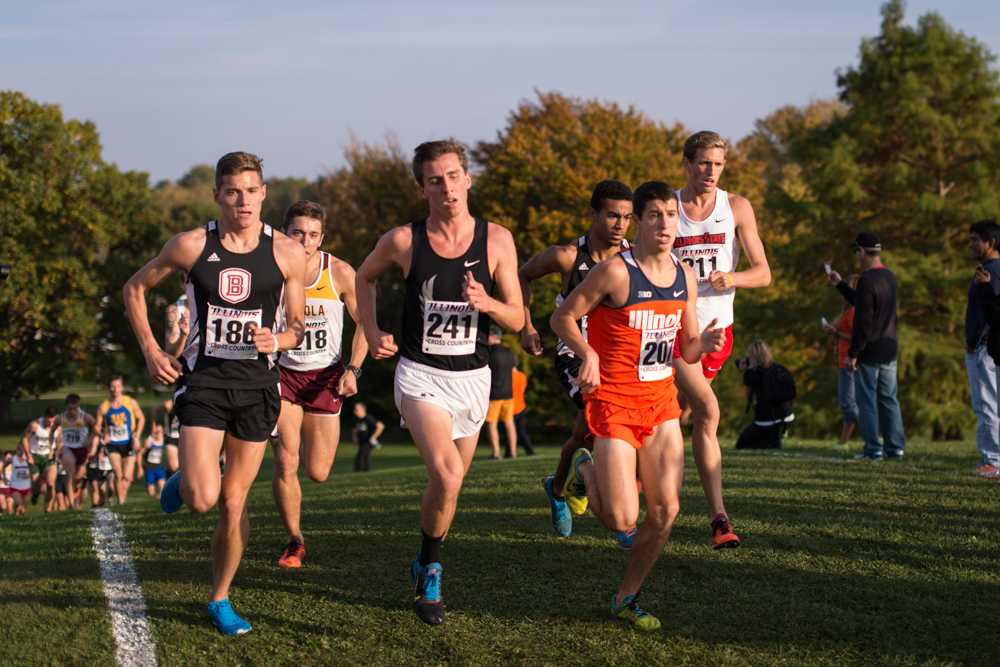 Illinois' Alex Gold (207), freshman, keeps pace with his opponents at the Illini Open 2014 at the Arborteum on October 25th.
