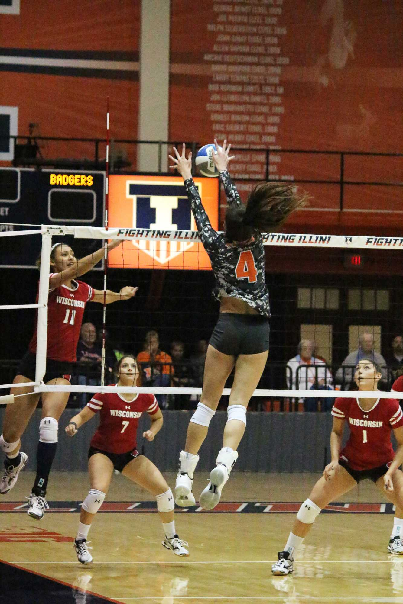 Michelle Strizak jumps up alone to block the spike from Wisconsin at Huff Hall on Friday, Nov. 11, 2016. Illini lost to Wisconsin 0-3.