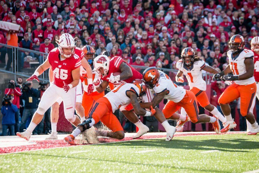 Wisconsin running back Corey Clement (6) runs through the Illinois defense for a touchdown during the first half of the game against Wisconsin at Camp Randall on Saturday.