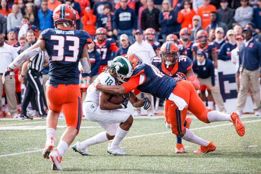 Illinois linebacker Hardy Nickerson (10) tackles Michigan State wide receiver Felton Davis III (18) during the game against Michigan State at Memorial Stadium on Saturday, November 5. The Illini won 31-27.