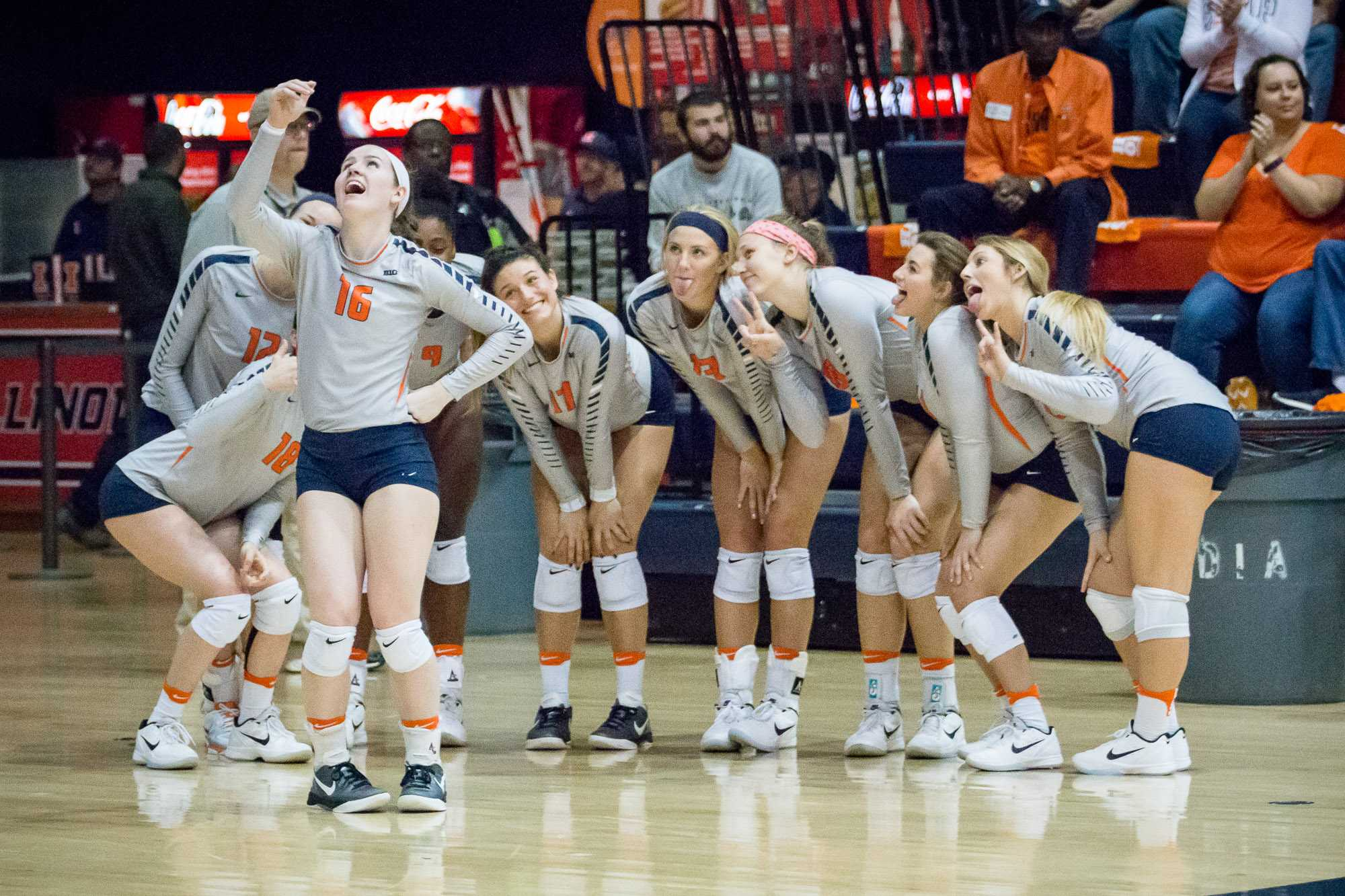 Illinois' McKenna Kelsay leads the bench in celebration by taking a selfie during the match against Northwestern at Huff Hall on Saturday, October 15. The Illini won 3-0.