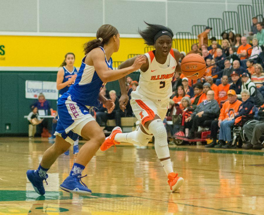 Guard Cierra Rice sprints up the court during the game against Tennessee State at Parkland College on Nov. 24. Illinois won 98-43.