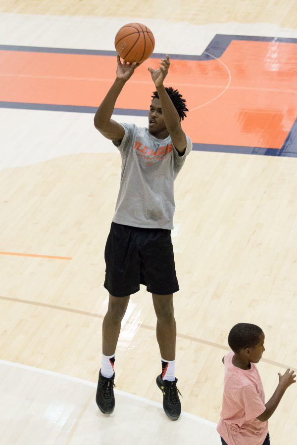 Five-star small forward Kris Wilkes takes a jump shot during an open practice at Ubben Basketball Complex on Saturday, September 10. Wilkes has not yet committed to play basketball at Illinois.