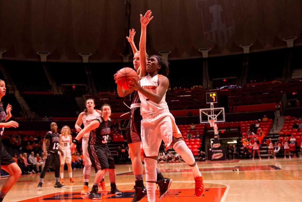 Illinois' Cierra Rice goes up for a layup during the game against Southern Illinois at the State Farm Center on Tuesday, December 8, 2015. The Illini won 78-64.
