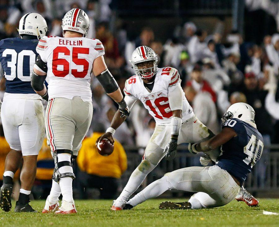 Ohio State quarterback J.T. Barrett (16) is sacked by Penn State linebacker Jason Cabinda (40) late in the fourth quarter on Saturday, Oct. 22, 2016, at Beaver Stadium in State College, Pa. Penn State won, 24-21. (Adam Cairns/Columbus Dispatch/TNS)
