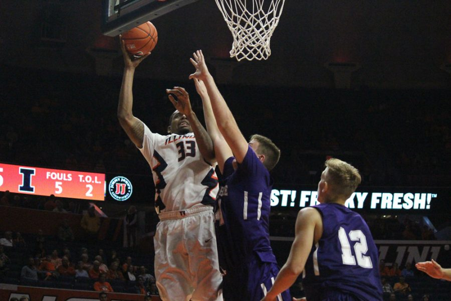 Mike Thorne Jr. (33) prepares to dunk the ball to score against McKendree.