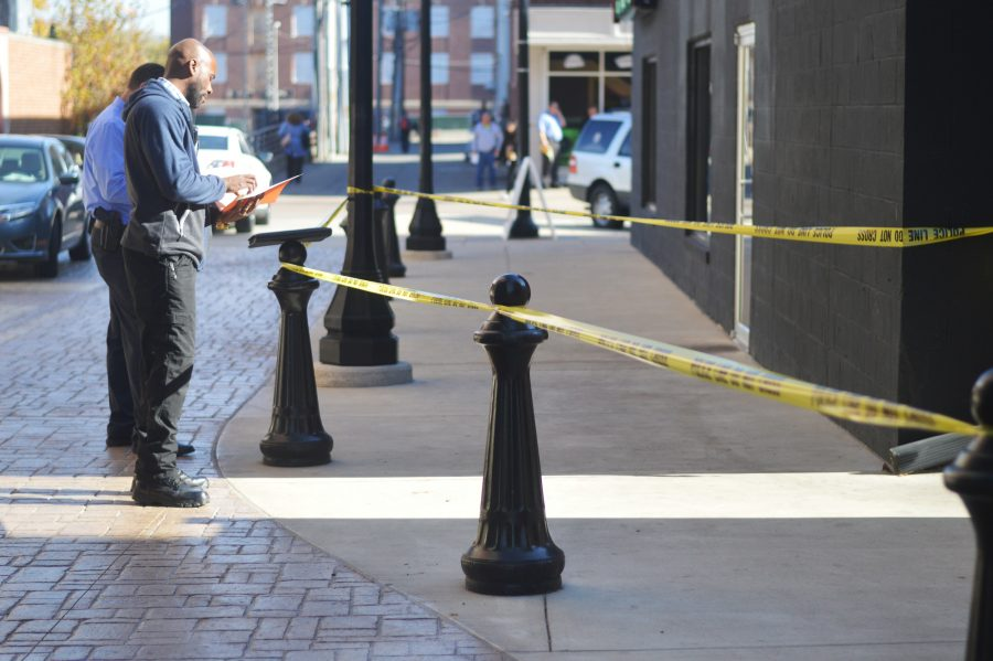 Sgt. Carter of the University of Illinois Police Department monitors the investigation site near the intersection of Sixth and Green streets on Wednesday.