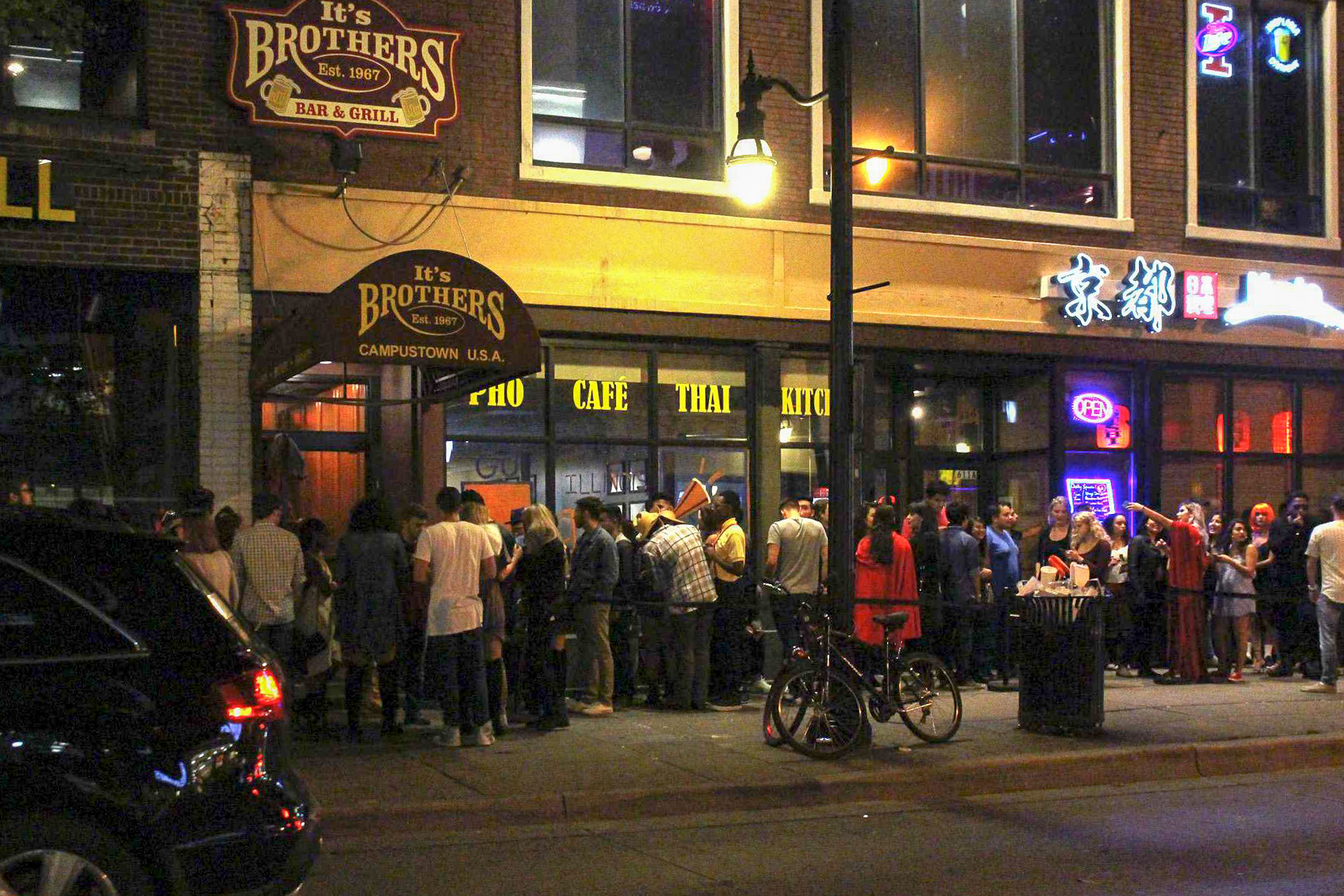 Students wait in line at Brother's Bar.