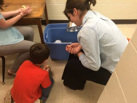 Ellie Gallo, student teacher at the Carrie Busey Elementary School in Savoy (part of Champaign school district), sits with kids during class.