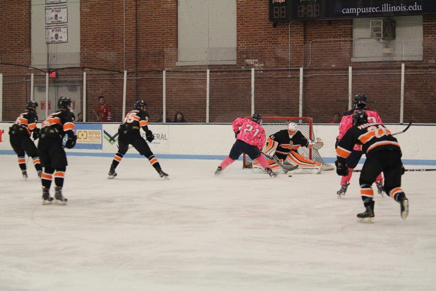 Luke Forfar (21) takes the puck past Indiana Techs defensemen to get a shot on goal at the Ice Arena on Friday, Oct. 14, 2016. Illini beat Indiana Tech 7-2.