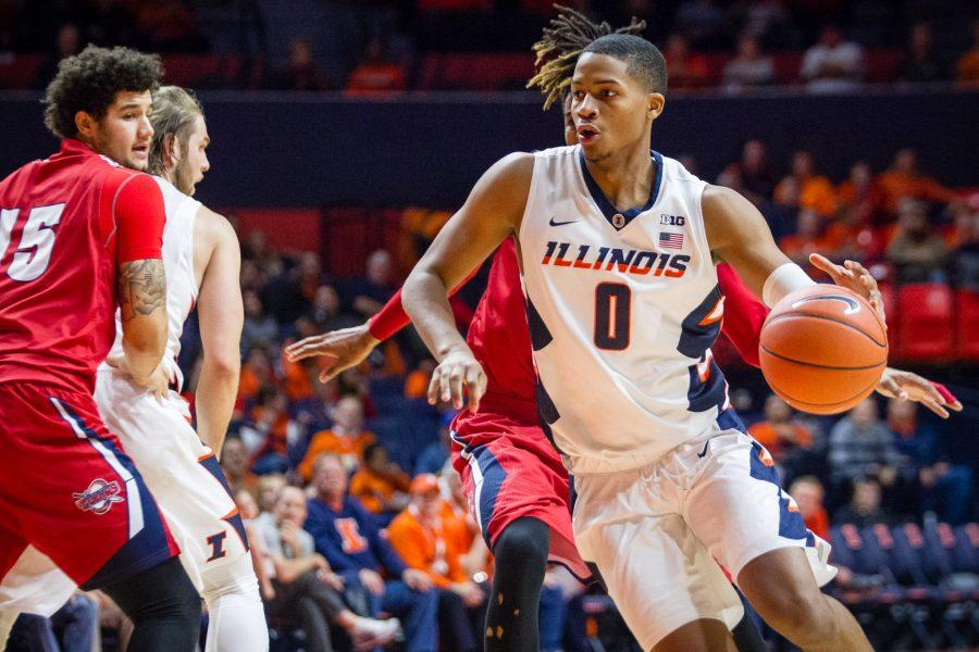 Illinois%27+D.J.+Williams+drives+to+the+basket+against+Detroit+at+State+Farm+Center+on+Nov.+18.+
